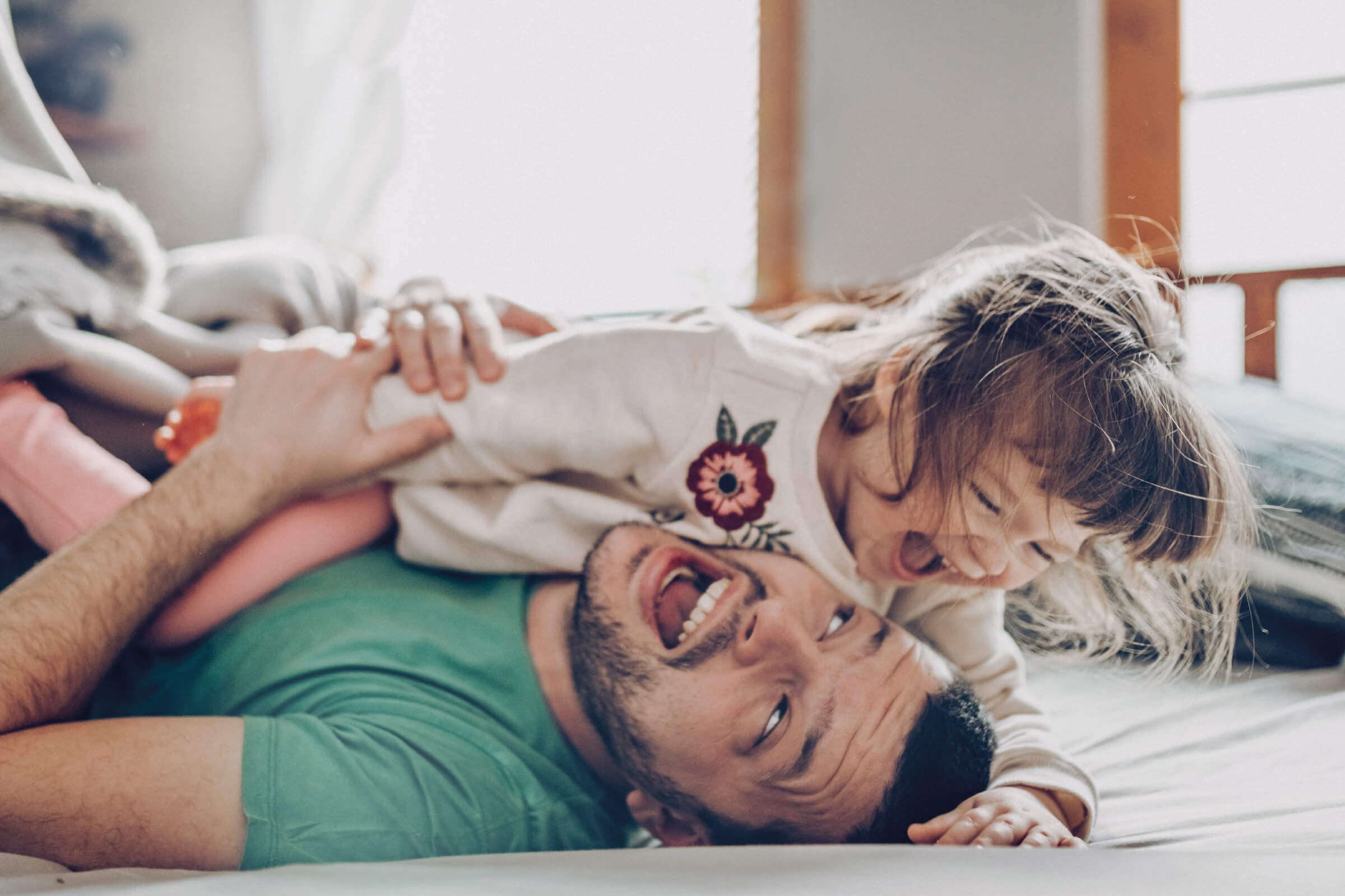 Father playing with laughing child